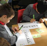 Children practising letter formation in school